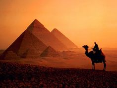 see the pyramids at sunset