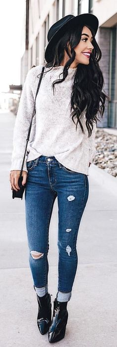 #winter #outfits red lace long-sleeved shirt, blue-washed distressed jeans and pair of black leather heeled boots
