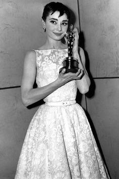 Audrey Hepburn for Roman Holiday  The start of a beautiful fashion friendship, the 1954 Oscars marked the first time Hepburn had worn a Hubert de Givenchy dress in public. The dress was originally designed by Edith Head as part of Hepburn's Roman Holiday wardrobe, but was adapted by Givenchy for the Oscars. Soon after winning the award, Hepburn insisted that it stated in her film contracts that Givenchy designed all her costumes.