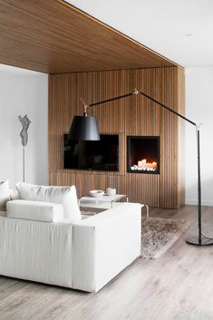Apartment Cozy Fireplace Idea In The Living Room Use White Fabric Sofa Incredible Apartment Design For Book Lovers Modern Apartment Design, Apartment Interior, Home Interior Design, Interior Architecture, Modern Design, Timber Battens, Wood Slats, Wood Paneling, Barcelona Apartment