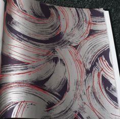 Silver Paint Swirls with Red on Purple Background | Glitter