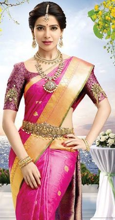 South Indian bride. Gold Indian bridal jewelry.Temple jewelry. Jhumkis.Pink silk kanchipuram sari.Braid with fresh jasmine flowers. Tamil bride. Telugu bride. Kannada bride. Hindu bride. Malayalee bride.Kerala bride.South Indian wedding. Samantha Prabhu.