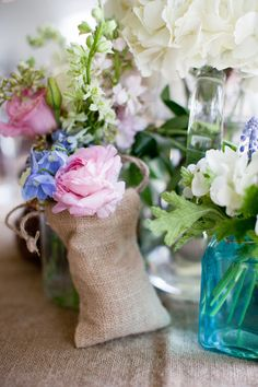 Flowers, linen bag, colored bottles