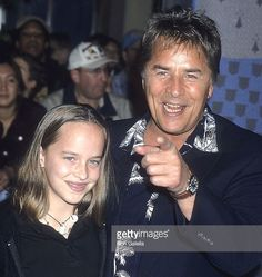 #Happybirthday #dakotajohnson who is 27 today! Here's a cute shot of then 11 yr old Dakota with her dad actor @DonJohnson at the 'Harry Potter and the Sorcerer's Stone' Westwood Premiere on Nov 14 2001 in Westwood CA. Her mom is #actress @melaniegriffith57  #happybirthdaydakotajohnson #fiftyshadesofgrey #dak #fiftyshadestrilogy #fiftyshades #bornthisday #actress #model #melaniegriffith #anastasiasteele @fiftyshadesmovie #famousdaughter #hollywood #ron_galella