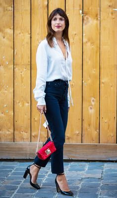 Keep it simple with a classic blouse and black skinny jeans.