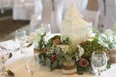 lanterns and foliage tablecentre piece Replace with silver moroccan style lantern