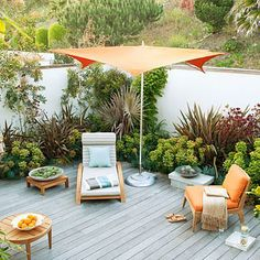 Backyard inspo. That pop of color is lovely. Patio/furniture/sail inspiration. The fence/wall.