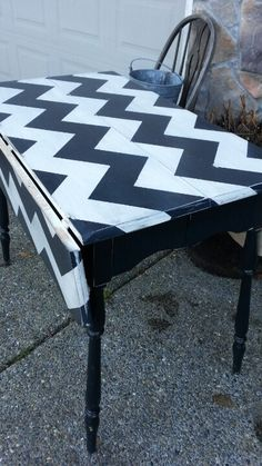 Vintage solid wood drop leaf table, painted black and white chevron. I want to do this with the little table in the garage! It would look great as a sewing/craft table.