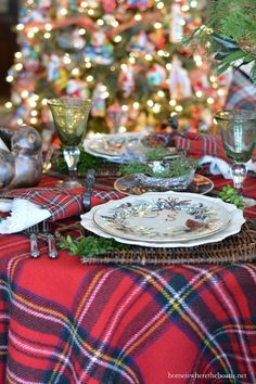 Christmas table with greenery arrangement with birds and tartan | homeiswheretheboatis.net #plaid