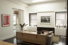 Living Room with Escea fireplace and Zuster Pearl Buffet. Brooke Aitken Design