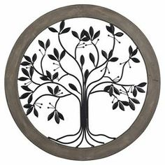 """Showcasing  a metalwork tree within a warmly weathered wood frame, this nature-inspired wall decor offers a lovely finishing touch for your living or dining room.   Product: Wall decorConstruction Material: Wood and metalColor: Natural and greyDimensions: 35"""" Diameter"""