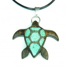 For our partnership with Sea Turtle Conservancy, we have created a special line of handmade turtle-themed items. For every sale of an item from the Sea Turtle collection, 20% will be donated directly to STC.  This sea turtle pendant is handmade from Black Limba wood. The inlay is crushed turquoise stone. Black Limba wood originates from tropical Western Africa. The colour of the wood varies. However, the shade of this piece is dark patina green.