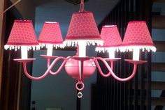 Pink painted chandelier with fabric lampshades
