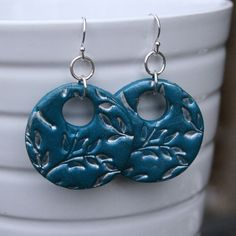 Blue, imprinted, polymer clay earrings.  The link goes to an Etsy shop and this item's not available.  Just use this picture as inspiration.