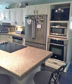 This kitchen went from old outdated oak cabinets to fresh and modern with GF Antique White Milk Paint and satin High Performance Topcoat.