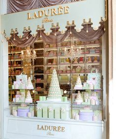 Move those glass cake shelves to the windows and use them for sales!