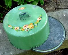 scrumptous vintage covered tin cake server cake carrier floral decals sea foam green. $19.99, via Etsy.