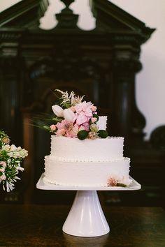 flower topped cake, photo by Redfield Photography http://ruffledblog.com/romantic-philadelphia-wedding #weddingcake #cakes