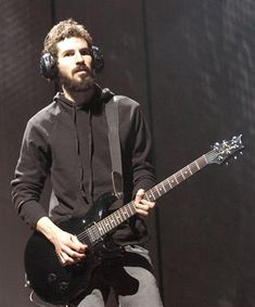 BRAD DELSON guitarist for Linkin park, collector of headphones...