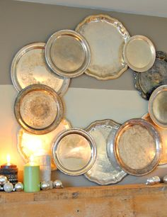 Clever use of mismatched silver trays to create a giant Christmas wreath over the mantle.
