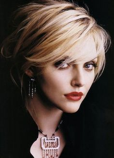 Choppy layers Styles for Short Hair: Choppy layers are added to the sides to get the short crop more feminine. The bangs are swept straight across, drawing people's attention to the eyes. The short layered hairstyle has the vertical length that gets it ideal for longer face shapes.