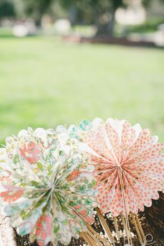 Colorful Paper Fans || On Style Me Pretty:    http://www.StyleMePretty.com/california-weddings/2014/02/20/blush-pink-wedding-at-the-athenaeum/ OneLove Photography