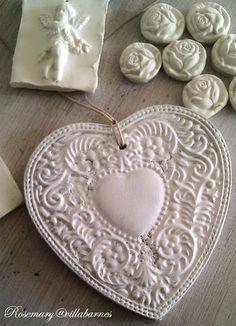 Villabarnes plaster creations.  White lacy heart ornament
