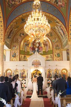 Ceremony at Ascension Greek Orthodox Church  Photography: Brett Matthews Photography Read More: http://www.insideweddings.com/weddings/classic-greek-orthodox-ceremony-modern-reception-in-new-york-city/702/