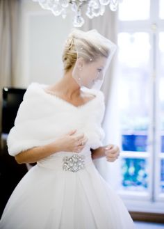 Adorable Winter Snow Wedding Ideas- This veil is lovely on her.
