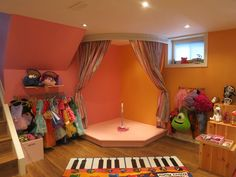 kids corner stage, rain gutter book shelves, kids playroom