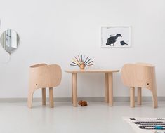Elephant chairs and table in matte lacquered European beech.