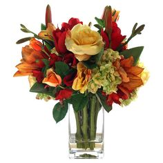 Faux tulip and lily arrangement with roses and hydrangea in a clear glass vase.  Product: Faux floral arrangementCon...