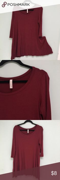 """Burgundy A-line Tunic Very comfy, flowing, jersey like soft material with three quarter length sleeves and a round neckline - 30"""" long from the shoulders to the bottom - no holes or stains Love In Tops Tunics"""