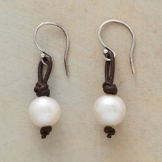 "RUSTIC PEARL EARRINGS -- The classic pearl earring goes modern with knotted leather loops that play off the luster with casual cool. Sterling silver French wire. Handmade in USA for Sundance. 1-1/4""L."
