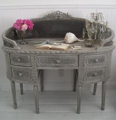 Carved French Cane Desk. I would love to paint it an antique white and distress it. I love it!