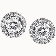 Suárez: Pendientes de oro blanco con diamante central y orla de brillantes. 0,20 quilates + 0,15 de orla.