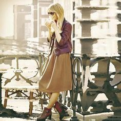 Pin for Later: 28 Different Looks You Can Achieve With 1 Leather Jacket Go For Autumnal Tones With a Neutral Midi Skirt