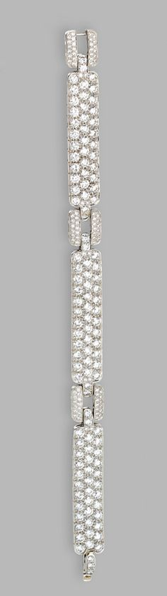 PLATINUM AND DIAMOND BRACELET, TIFFANY & CO.  Set with round diamonds weighing approximately 18.00 carats, length 7¼ inches, signed Tiffany & Co.