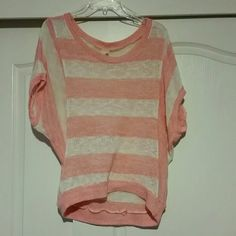 * NWOT coral and white stripe Dolman NWOT coral and white stripe top. Really cute top for spring and summer. Made from a lightweight knit material. Would be really cute with some cut off shorts and sandals for a day by the beach! Size medium but I'm a small and it fits me just fine since it's meant to be loose fitting. Francesca's Collections Tops