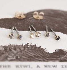 Diamondz & Pearlz Studs, featuring rough grey and black diamonds and freshwater pearls.  From $75.