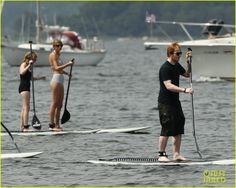 """Taylor Swift and Ed Sheeran took a break from their touring schedule to have some fun in the sun. They rented paddleboards with some friends over the weekend in Westerly, Rhode Island. Taylor wore a cute retro black-and-white striped bikini with high-waisted bottoms. She added cat-eye sunglasses and her signature red lip. Ed also stuck to his style, wearing long trunks and a black tee. In related Taylor tour news, she joined Carly Simon on stage to sing Carly's hit """"You're So Vain"""". Here"""