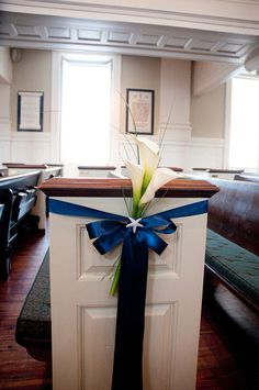 Calla Lily Pew Decor. With a memorial picture instead of starfish