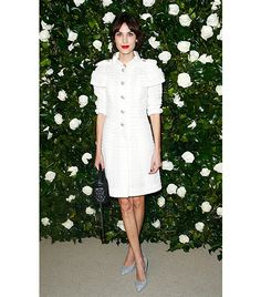 Chung wore a white Chanel Spring 2013 Couture tweed dress with ice blue pumps,