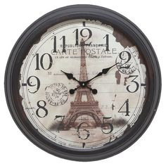 Metal wall clock with an Eiffel Tower motif and distressed face detailing.  Product: Wall clockConstruction Material...