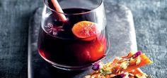 Kick off your mid-winter dinner party with this piping hot mulled wine whiskey, served alongside a sweet and salty brittle.