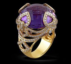 Amethyst & Diamond Ring Amethyst ring with diamonds set in 18k yellow gold.