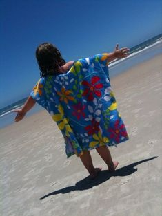 beach towel coverup. :) Remember my Gramma Bertha making us these when we were kids! For larger kids she used two towels and flipped down top for fringe, then sewed together leaving a head opening. Sides sewed the same as this one. :)