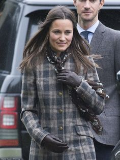 Pippa Middleton wore a grey marl checked coat to the service, completing the look with brown leather gloves and a floral print scarf
