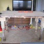 A table constructed from salvaged wood and architectural columns. Repurposed Wood, Salvaged Wood, Faux Wood Wall, House Columns, Cow Kitchen, Architectural Columns, Make A Table, Rustic Industrial, Wood Pallets