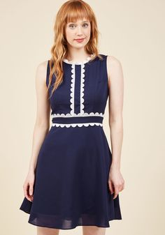 <p>Each new French phrase you learn gets you closer to feeling like a real Parisian - but this navy blue dress from Trollied Dolly boosts your progress significantly! With white, embroidered scallops accenting its tailored bodice and an easy-flowing A-line silhouette, this frock transports you to the cobblestone streets of Montmartre.</p>